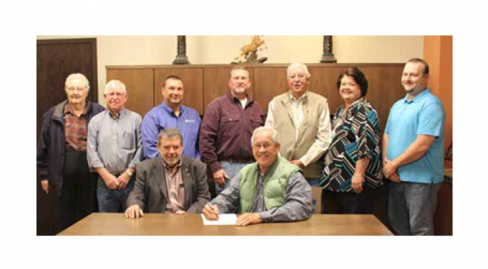 News article Clay County Electric official contract signing for solar field